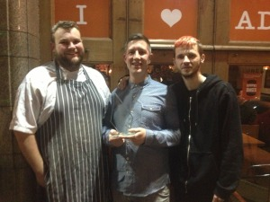 Fin Nicol, Chris May and Kyle McClernon of Buddy's BBQ celebrate their win