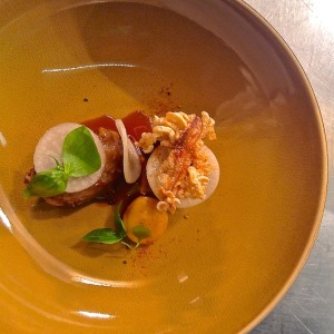 Aizle's dish of pork cheek, pig ear crackling, turnip, radish, watercress, togarashi
