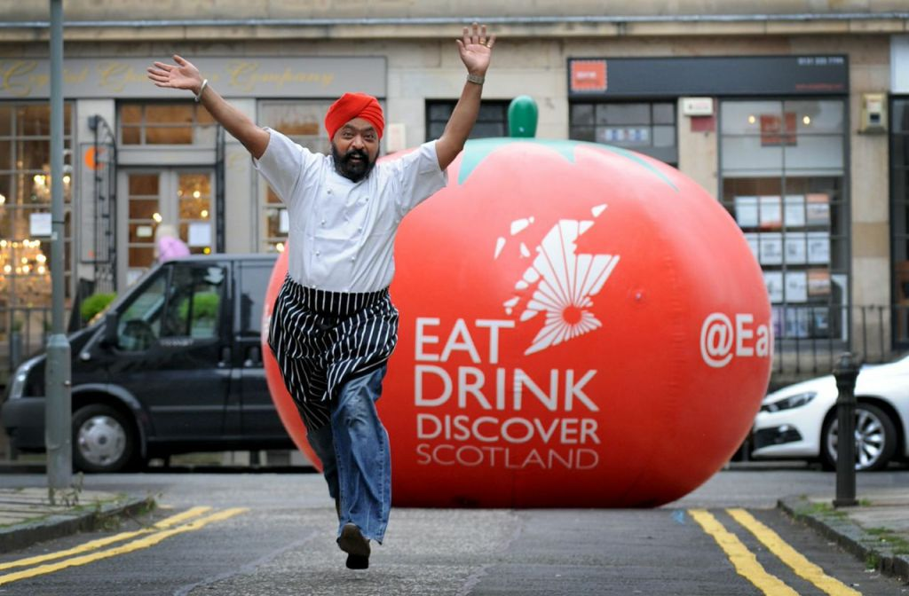 Tony Singh, presumably without the giant chasing tomato, is one of the chefs demoing at the event.