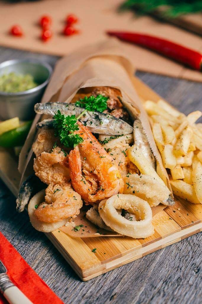 Misto de peixe: fresh white fish, calamari and tiger prawns, all fried and served on a bed of fresh salad or with chips.