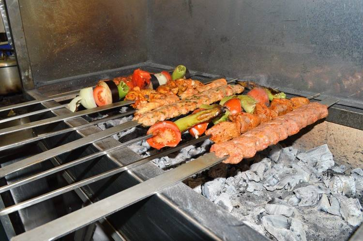 The charcoal grill at Rojava is seldom cool.